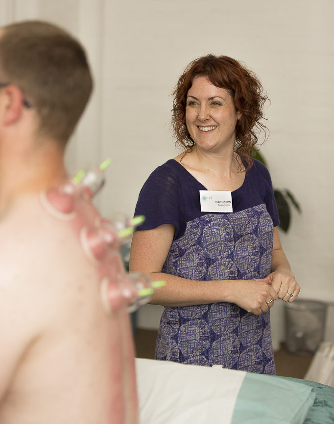 rebecca geanty explaining cupping therapy - with trademark grin
