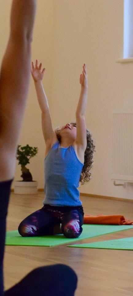 child practicing yoga